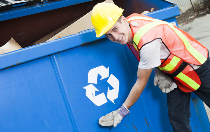 A worker who recycling thing on recycle center on the recycle garbage border
