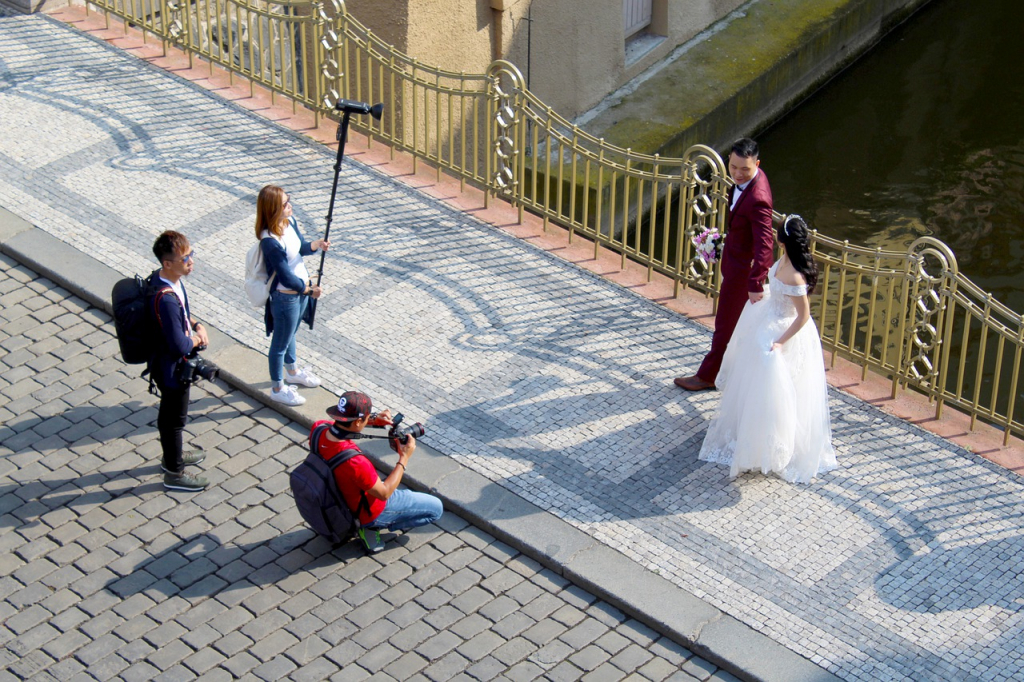 Wedding photographer and his team taking prenup photos with the couple.