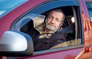 An elderly man getting a driving evaluation for seniors