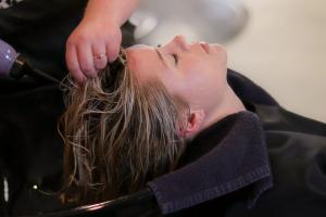 Woman receiving Shiseido hair straightening treatment