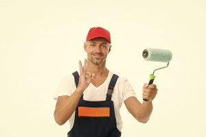 Male worker offering professional Melbourne painting services