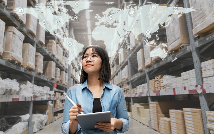 Female manager of a 3PL Warehouse doing an inventory